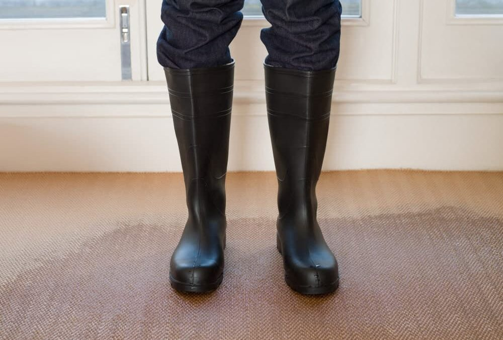carpet flood emergency person in black boots